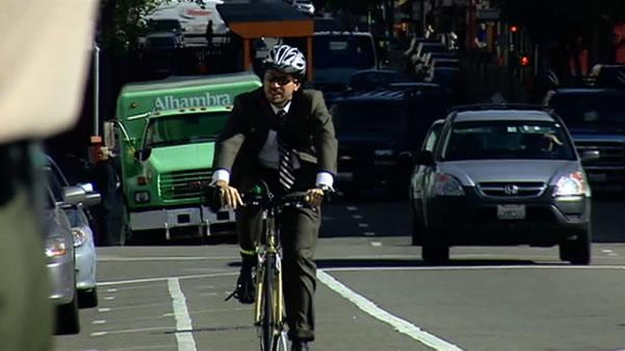 A man commuting by bicycle.