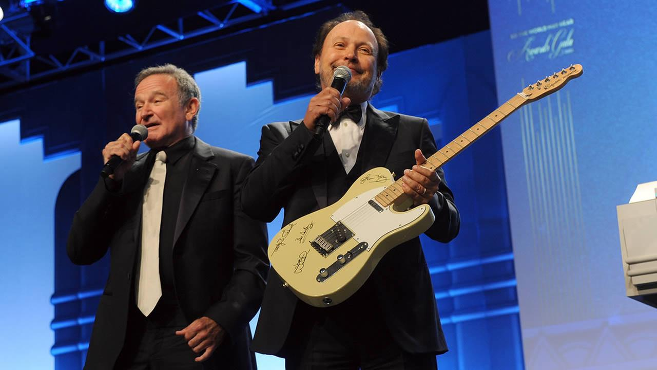 Robin Williams and Billy Crystal auction off a guitar autographed by the Eagles at the 12th Annual Starkey Hearing Foundation, August 4, 2012 in St. Paul, Minnesota. (Photo by Diane Bondareff/Invision for Starkey Hearing Foundation)