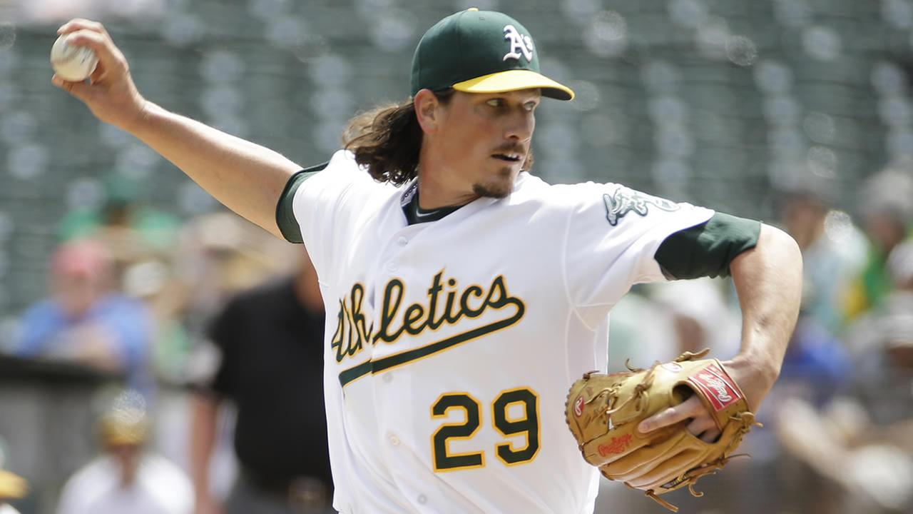 Oakland Athletics starting pitcher Jeff Samardzija throws in the first inning of their interleague baseball game against the New York Mets on Aug. 20, 2014, in Oakland, Calif. (AP Photo/Eric Risberg)