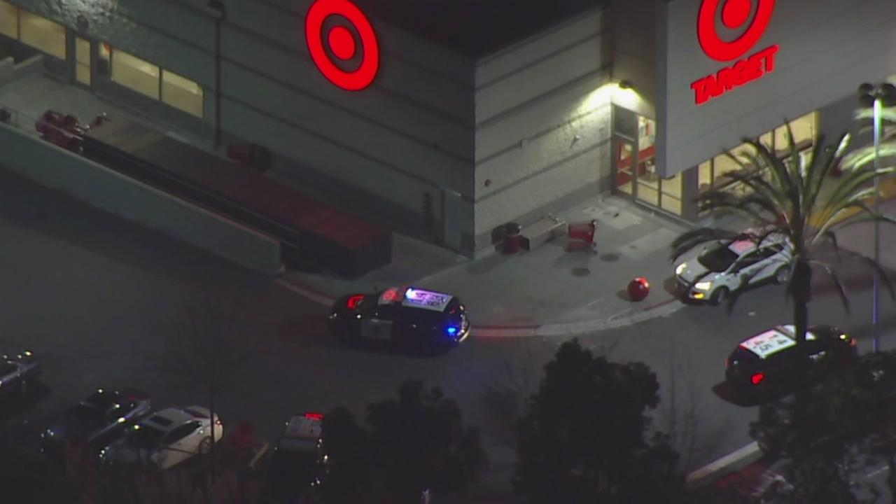 Police are seen outside a Target store in Emeryville, Calif. after a shooting in the parking lot on Monday, December 4, 2017.