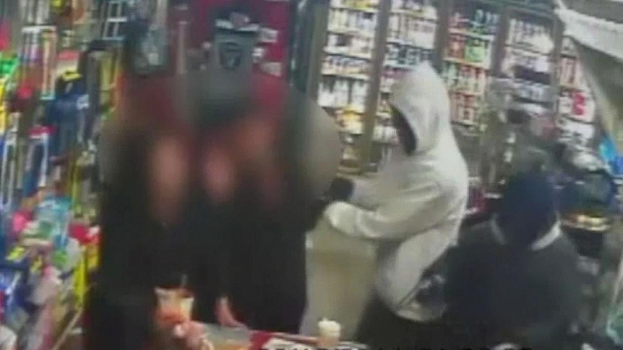 surveillance video a shooing and convenience store robbery