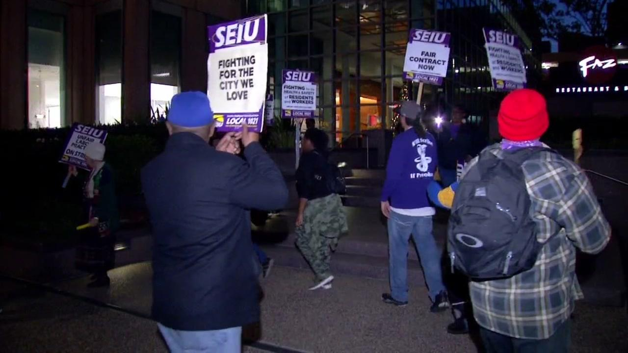 Oakland city workers picket in Oakland, Calif. on Dec. 5, 2017.