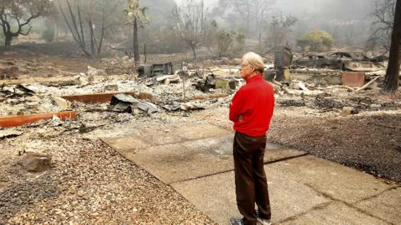 Mike Rippey looks over the burned out remains of his parents home at the Silverado Resort, Tuesday, Oct. 10, 2017, in Napa, Calif.