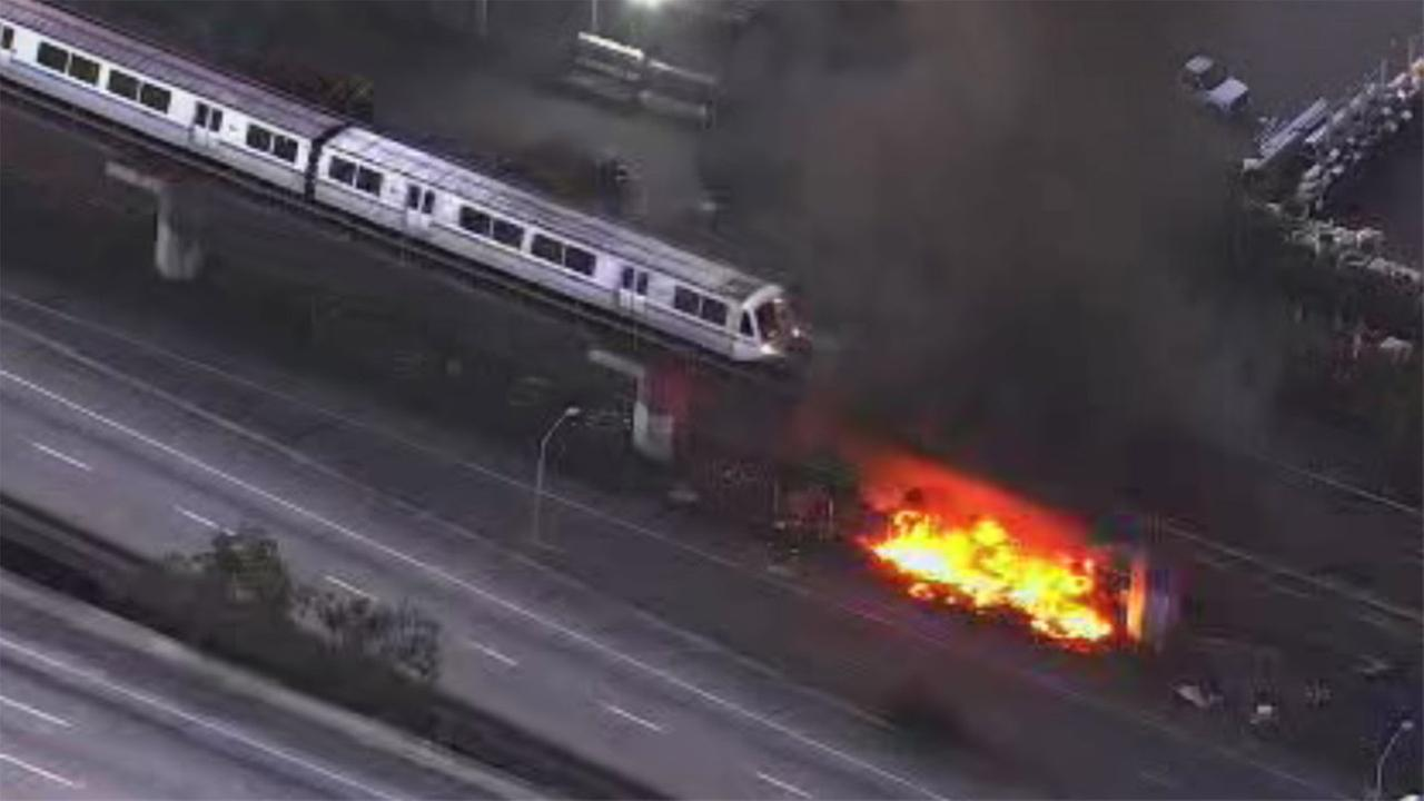 Fire burns dangerously close to BART tracks in Oakland, California, Thursday, December 7, 2017.