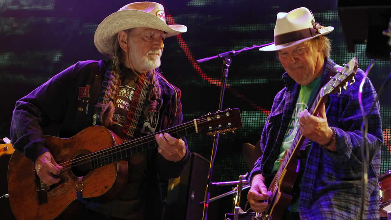 In this Sept. 22, 2012 file photo Neil Young, right, and Willie Nelson perform during the Farm Aid 2012 concert at Hersheypark Stadium in Hershey, Pa. (AP Photo/Jacqueline Larma, File)