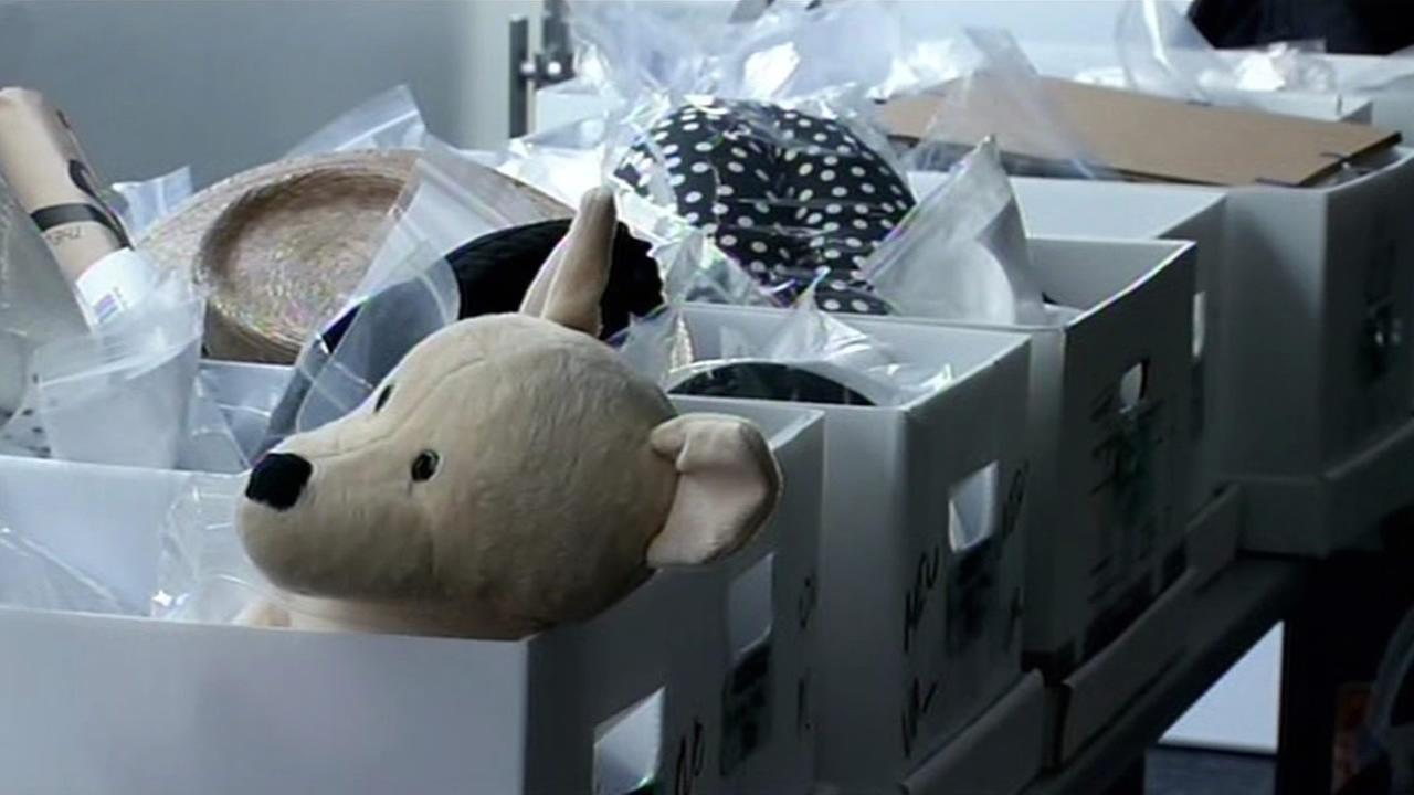 TSA shows off lost items at SFO.