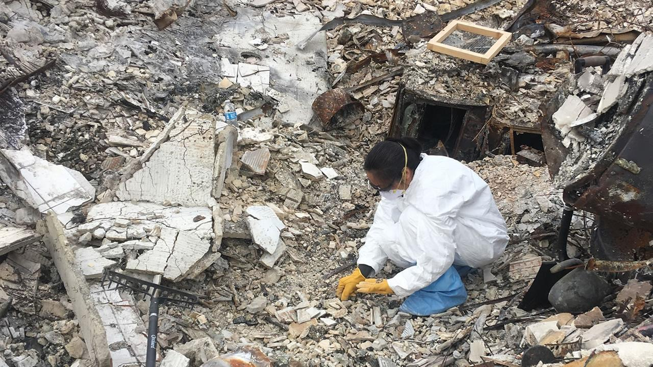 Patima Wong cleans up the ruins of her home in Santa Rosa, Calif. in this undated image.