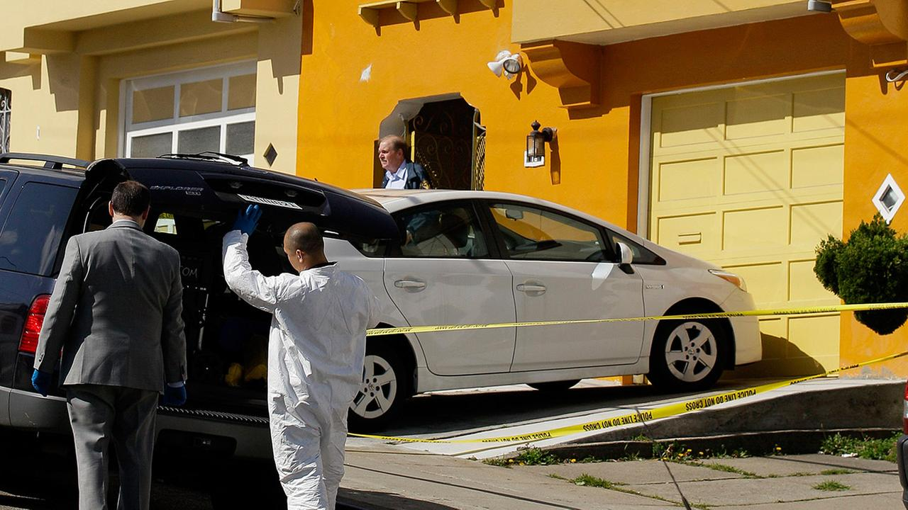 FILE - In this Friday, March 23, 2012 file photo, police officers inspect outside of a home on Howth Street in San Francisco where five members of a family were found dead.
