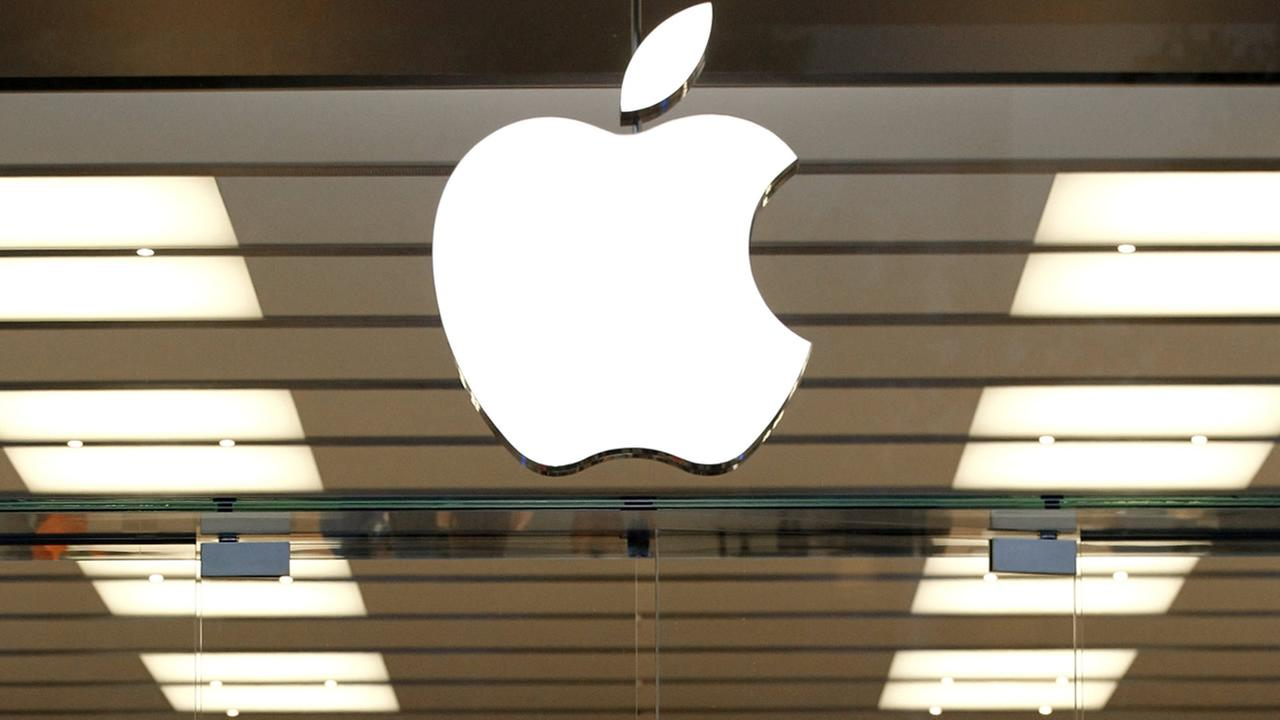 FILE - This Thursday, Sept. 19, 2013, file photo shows the Apple logo above a store location entrance in Dallas. (AP Photo/Tony Gutierrez, File)