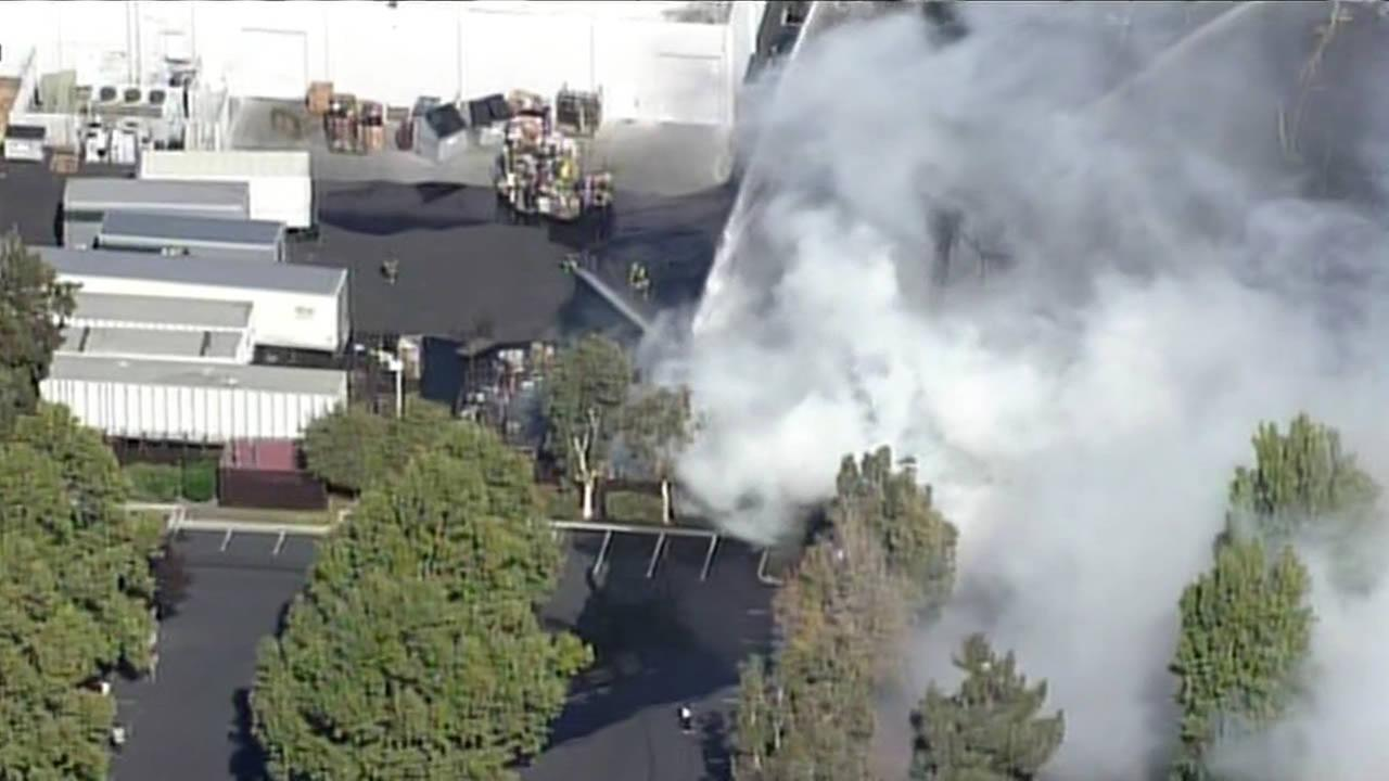 Fire burning in Hope Services parking lot in Santa Clara