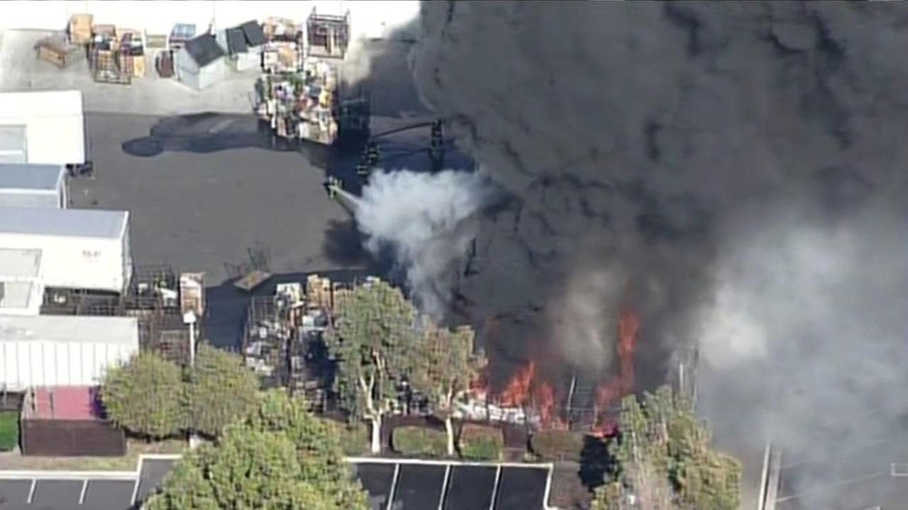 Crews battling large fire burning in parking lot of Hope Services in Santa Clara