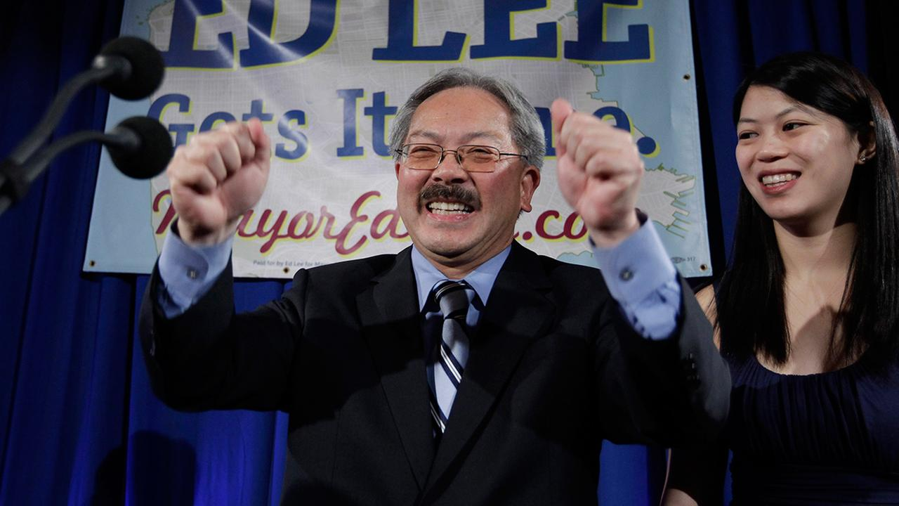 San Francisco interim mayor Ed Lee smiles as his daughter, Brianna, right, looks on at his campaign headquarters for mayor in San Francisco, Tuesday, Nov. 8, 2011.