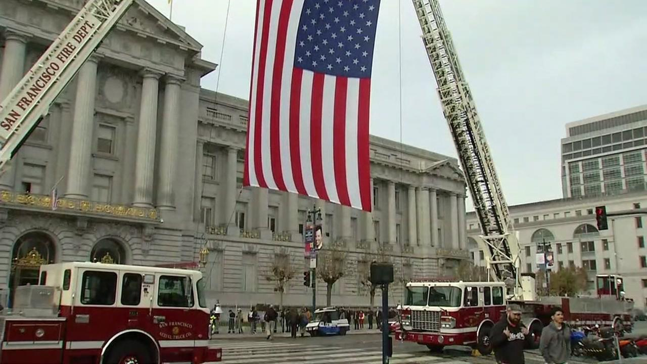 Mourners line up for public viewing of Mayor Ed Lee at San Francisco City Hall, Friday, December 15, 2017.