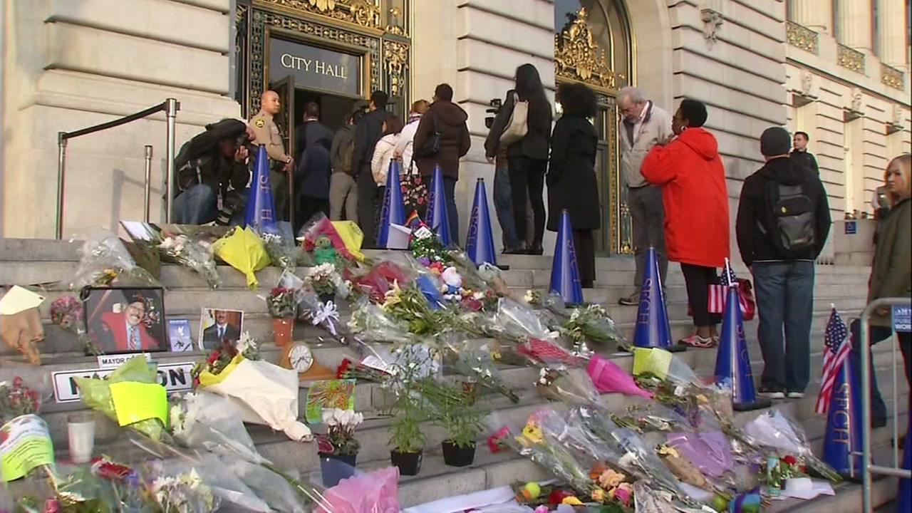 Flowers and mementos appear on the steps of San Francisco City Hall on the day of former Mayor Ed Lees funeral, Friday, Dec.15, 2017.