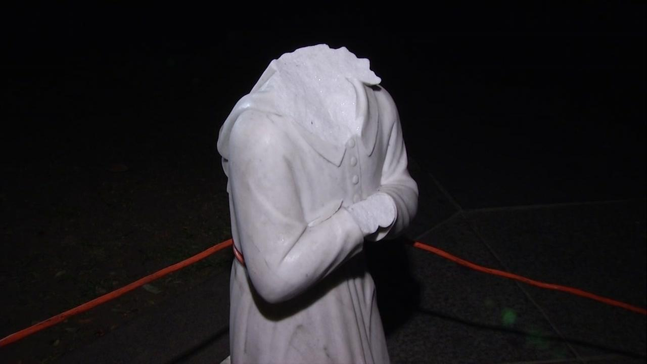 A beheaded statue appears at a Catholic church in Hayward, Calif. on Friday, Dec. 12, 2017.