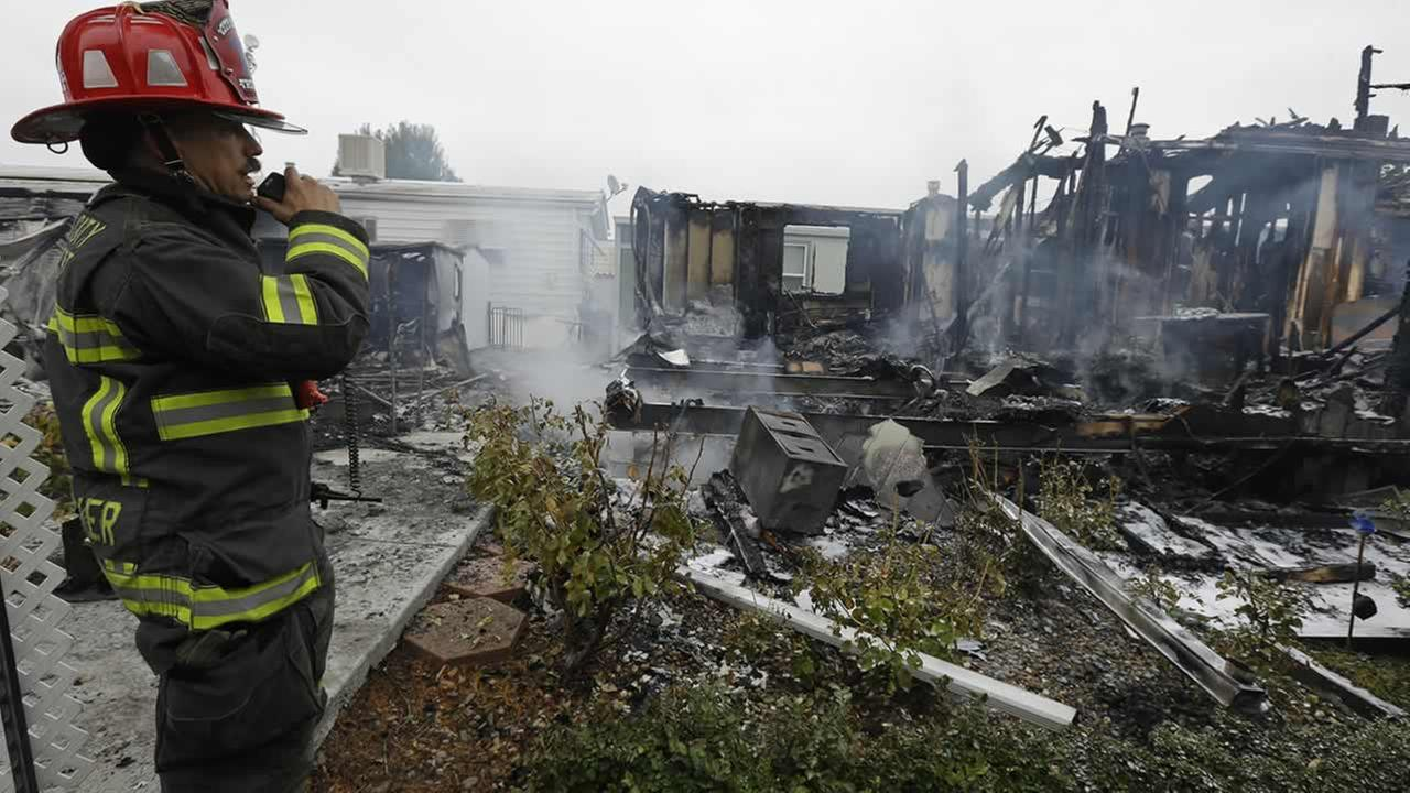 Napa Fire Captain Steve Becker inspects mobile homes which were destroyed Sunday, Aug. 24, 2014, at the Napa Valley Mobile Home Park, in Napa, Calif.  (AP Photo/Ben Margot)