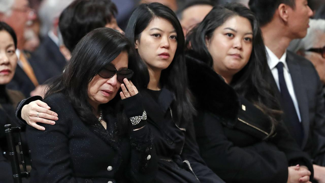 Anita Lee, far left, and her daughters, Brianna, middle, and Tania attend a service celebrating the life of Mayor Ed Lee at San Francisco City Hall on Sunday, Dec. 17, 2017.
