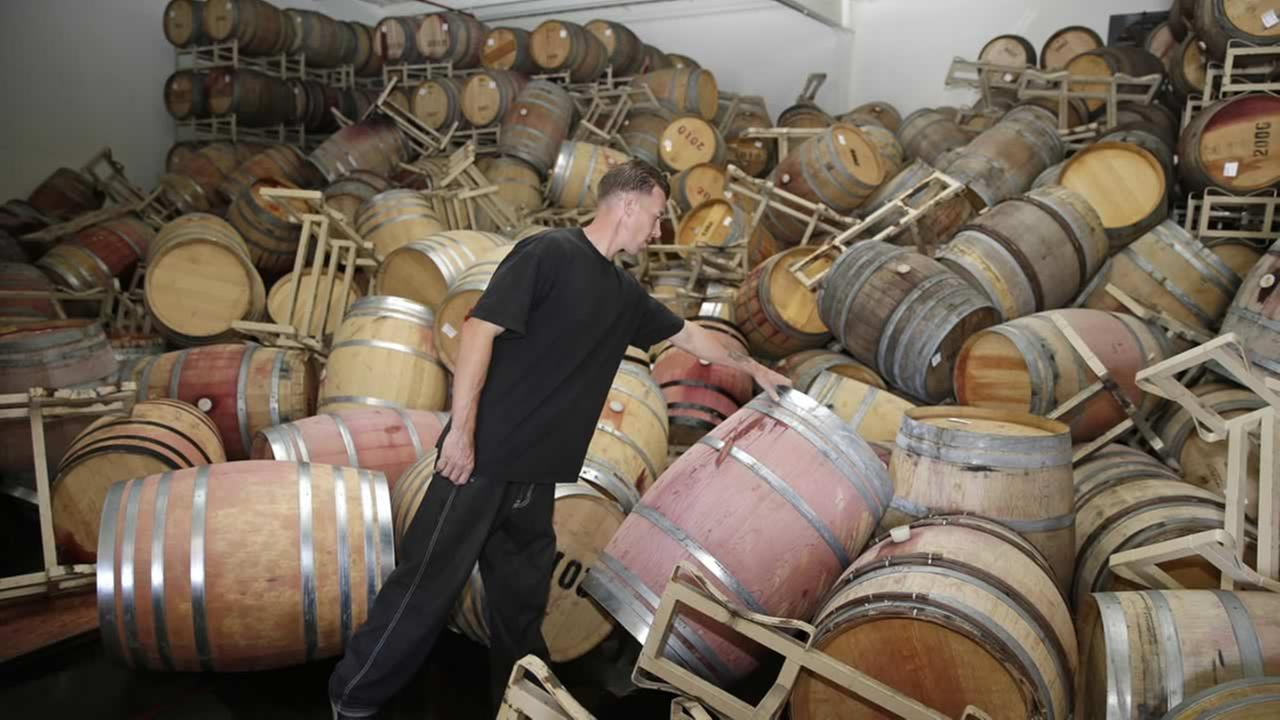 Cellar worker Daniel Nelson looks over toppled barrels of Cabernet Sauvignon following an earthquake at the B.R. Cohn Winery barrel storage facility Sunday, Aug. 24, 2014, in Napa, Calif. (AP Photo/Eric Risberg)AP Photo/Eric Risberg