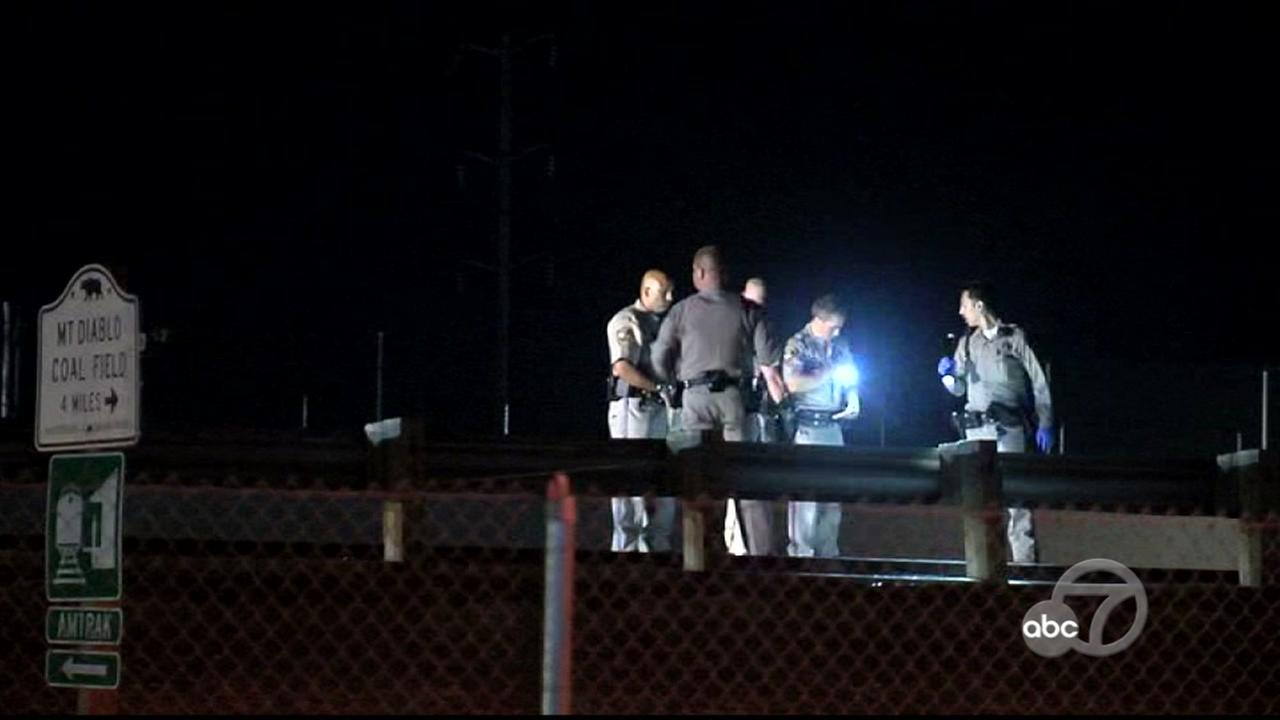 Officials investigate a Bay Area freeway shooting in this undated image.