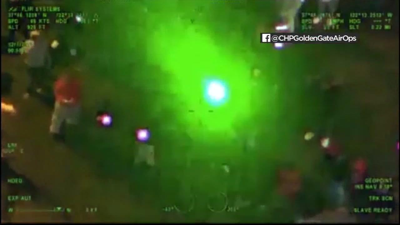 A laser light is seen pointed at a CHP helicopter during a sideshow in this undated image.