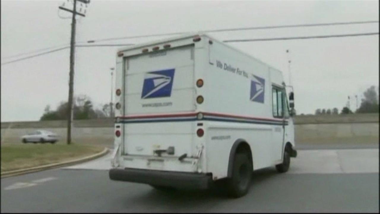 This is an undated image of a mail truck.