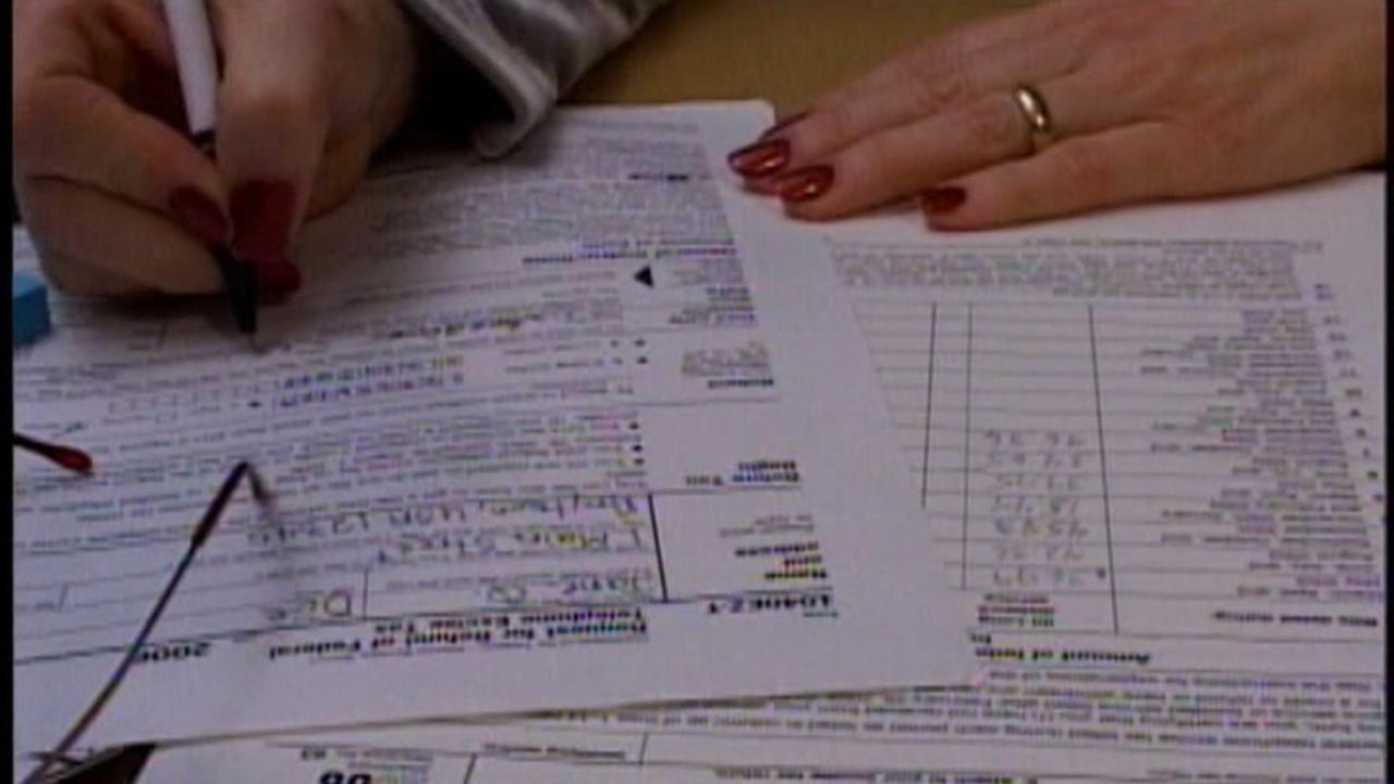 This is an undated image of a person filling out a tax form.