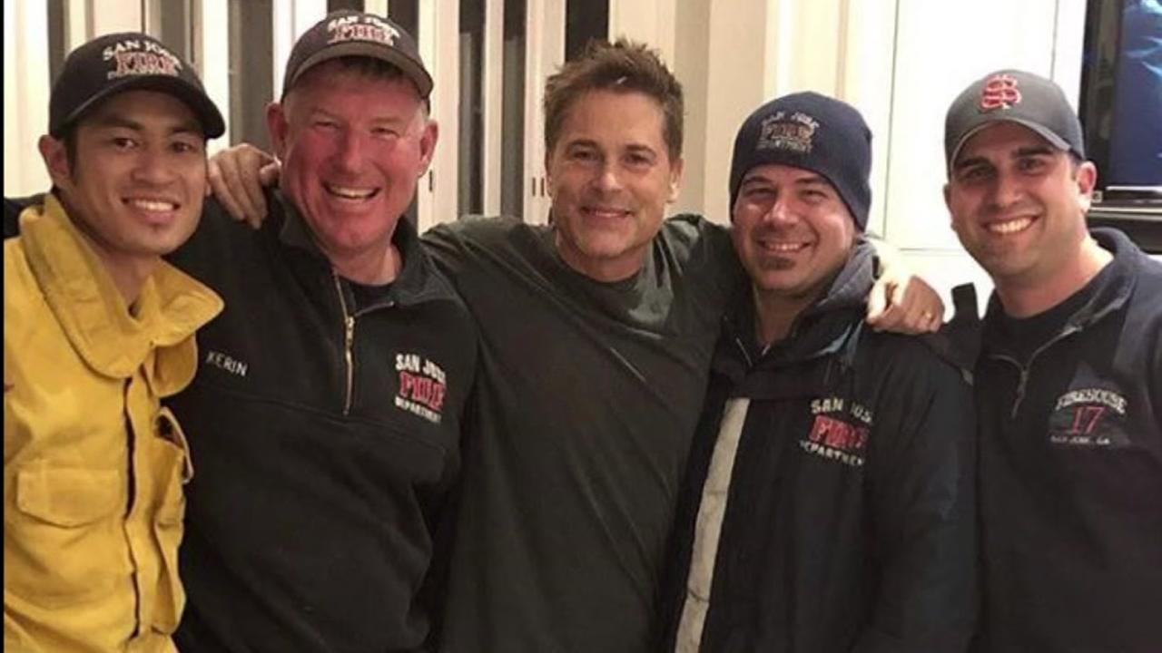 Firefighters from San Jose, Calif. take a photo with actor Rob Lowe on Sunday, Dec. 17, 2017.