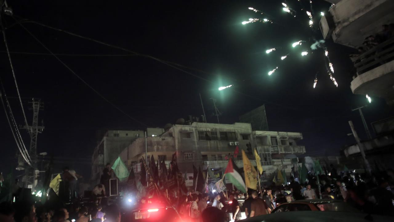Palestinians celebrate the ceasefire