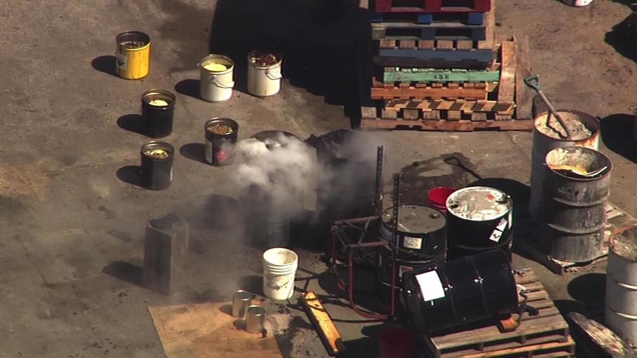 Smoke coming from barrels in industrial area of Hayward