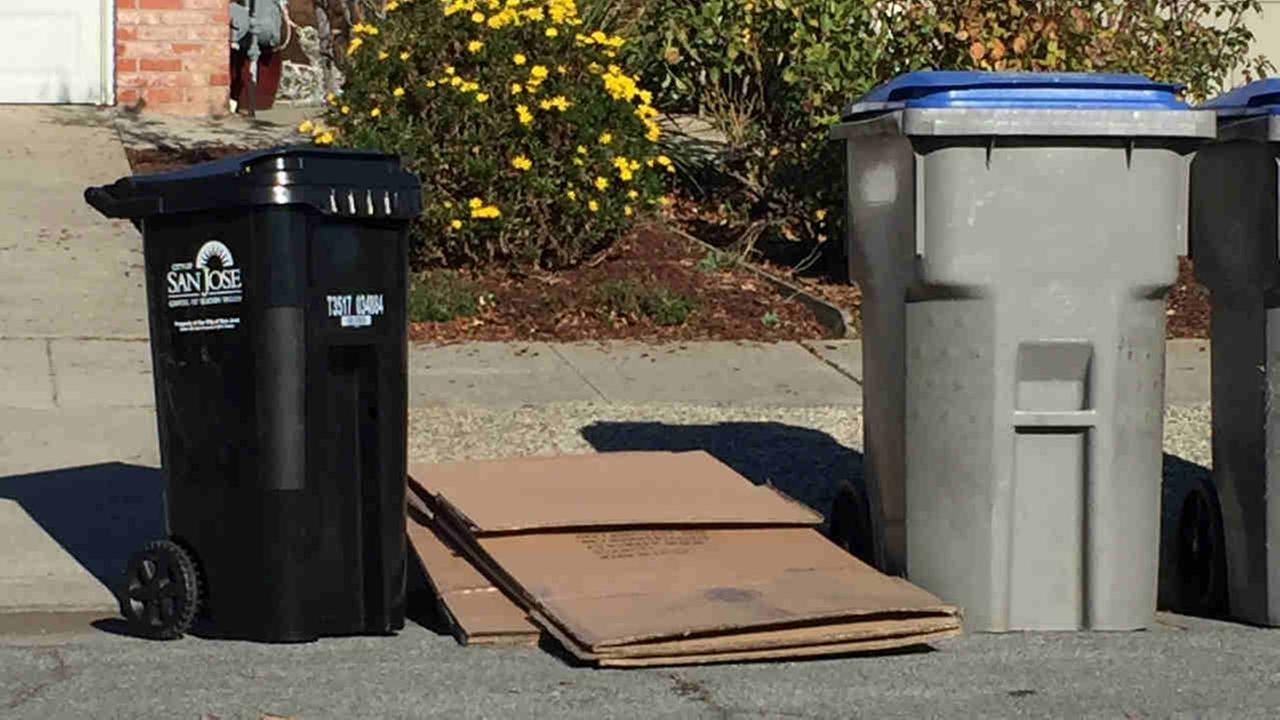 Cardboard boxes are seen on a curb in San Jose, Calif. one day after Christmas on Tuesday, Dec. 26, 2017.