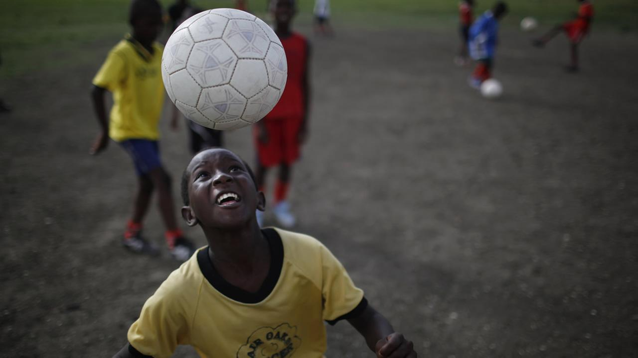 A youth plays with a soccer ball during a free soccer clinic in Port-au-Prince, Thursday, June 10, 2010. (AP Photo/Alexandre Meneghini