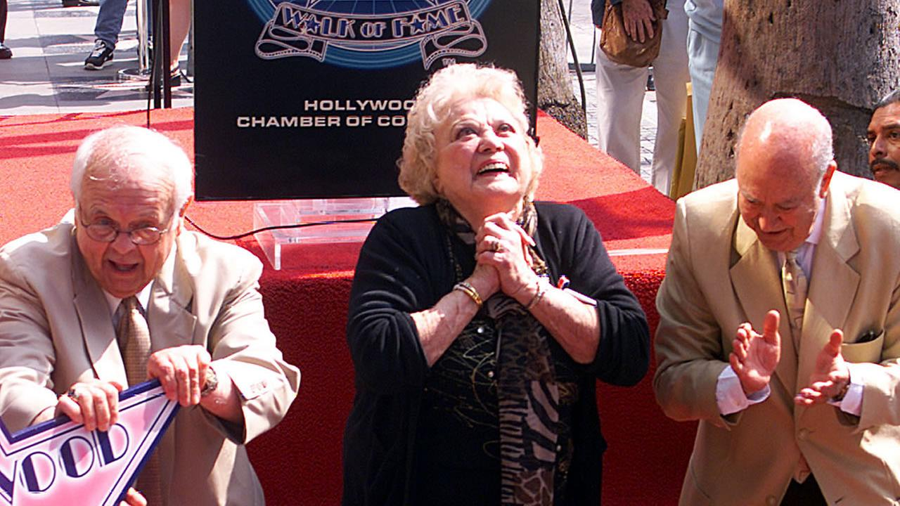 Rose Marie is gleeful as director Carl Reiner, right, and Honorary Mayor of Hollywood, Johnny Grant, present her with the 2,184th star on the Hollywood Walk of Fame in 2001.