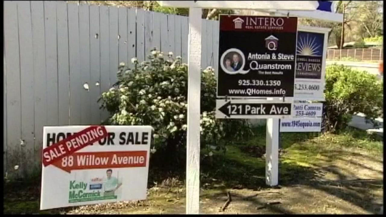 This is an undated image of real estate sale signs.