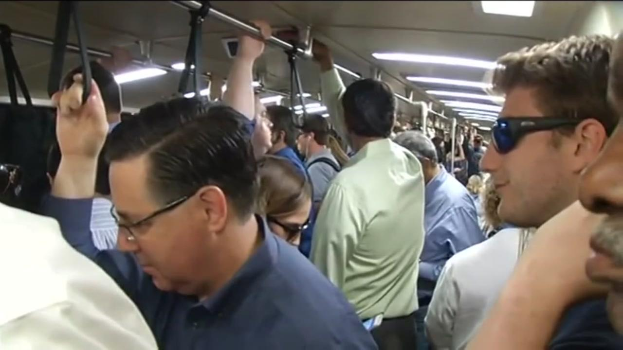 This is an undated image of people on a BART train.