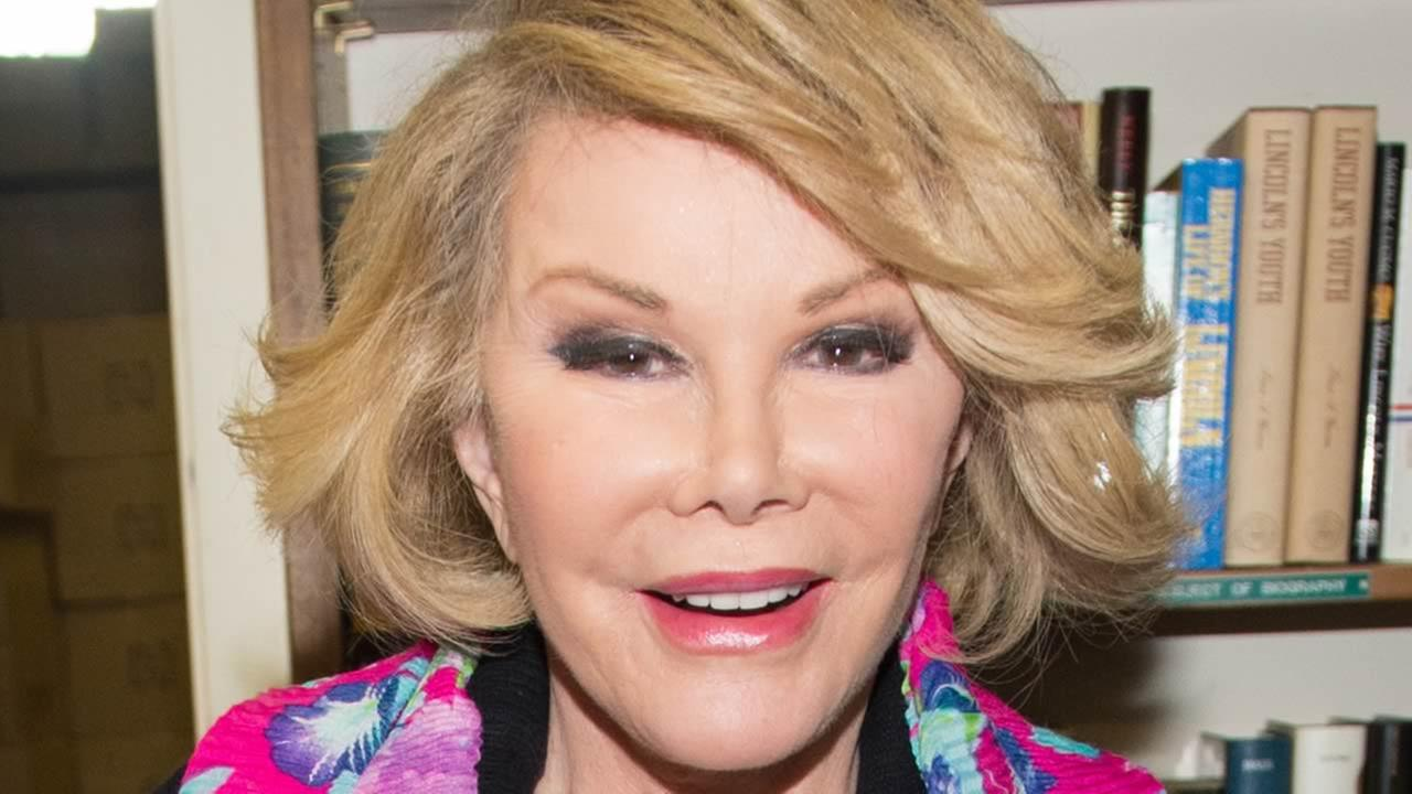 Television personality Joan Rivers makes an appearance at Book Revue to promote her new memoir Diary of a Mad Diva, in Huntington on Friday, July 25, 2014 in New York. (Photo by Scott Roth/Invision/AP)