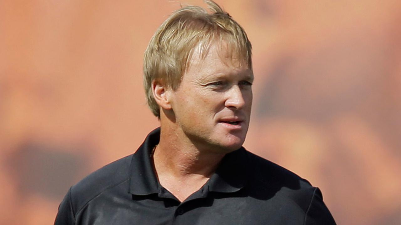 FILE - In this Aug. 15, 2014 file photo, Jon Gruden is shown at the Cleveland Browns training camp in Berea, Ohio.