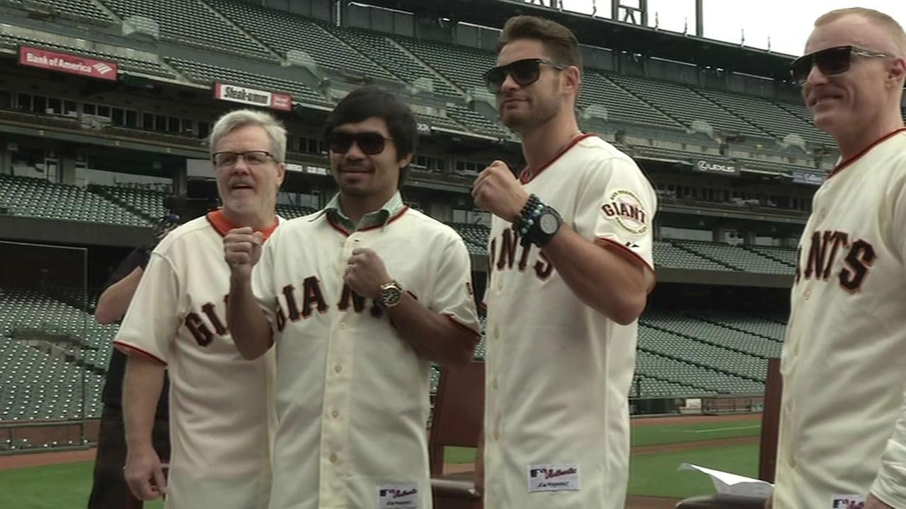 Boxing legend Manny Pacquiao and boxer Chris Algieri both threw out the ceremonial first pitch at the Giants game Friday night.