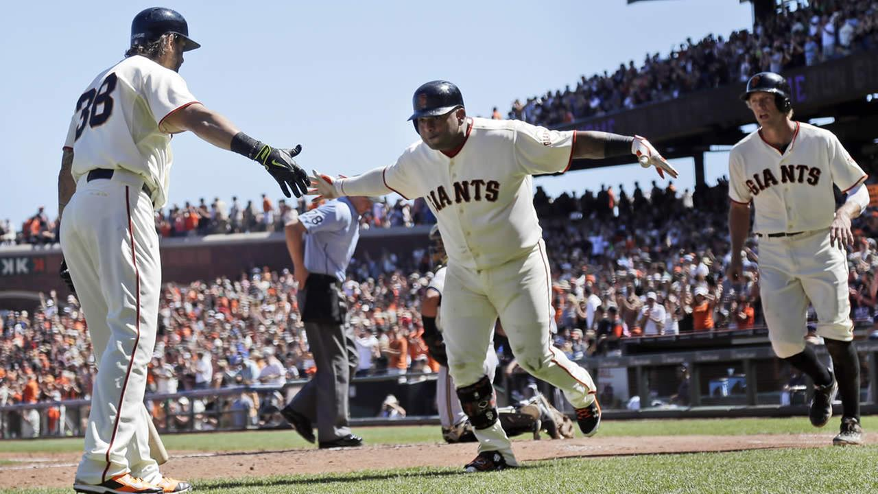Giants Pablo Sandoval, center, celebrates his two-run home run with teammate Michael Morse, left, on Sunday, Aug. 31, 2014, in San Francisco (AP Photo/Marcio Jose Sanchez)