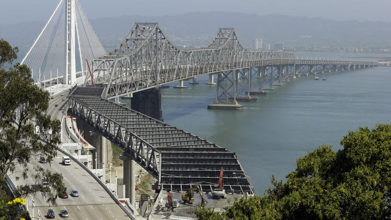 Workers dismantle the eastern span of the Oakland-San Francisco Bay bridge in this view from Yerba Buena Island.
