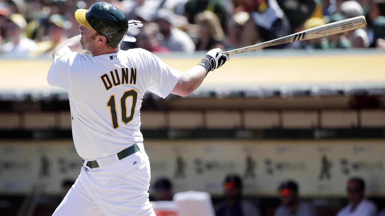 Oakland Athletics Adam Dunn hits a two-run home run against the Seattle Mariners during a baseball game on Monday, Sept. 1, 2014, in Oakland, Calif. (AP Photo/Marcio Jose Sanchez)