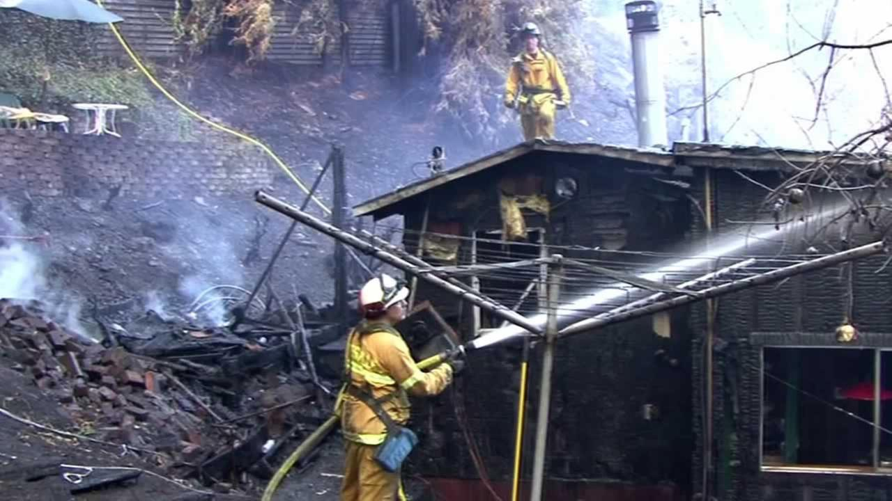 A firefighters battles a structure fire.