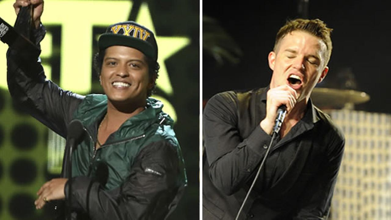 Bruno Mars is pictured, left, and Brandon Flowers from the Killers performs, right.