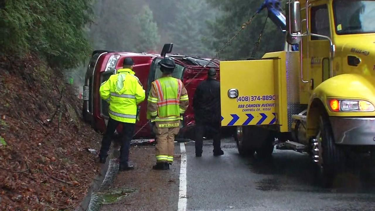 A rollover accident is seen blocking a lane of Highway 17 in the Santa Cruz Mountains near Santa Cruz, Calif. on Monday, Jan. 8, 2018.
