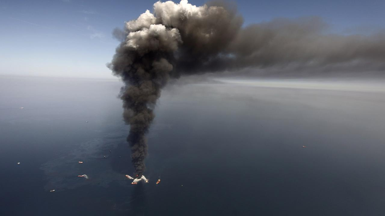 FILE - In this Wednesday, April 21, 2010 file photo, oil can be seen in the Gulf of Mexico, more than 50 miles southeast of Venice on Louisianas tip (AP Photo/Gerald Herbert)