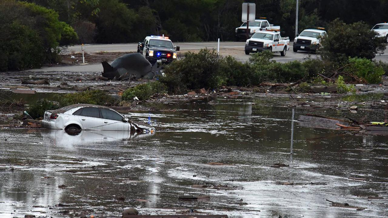 This photo by Santa Barbara County Fire Department shows Hwy 101 at Olive Mill Road overpass flooded from Montecito Creek in Montecito, Calif., Tuesday, Jan. 9, 2018.