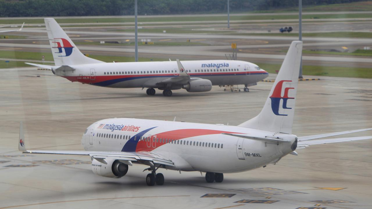 A Malaysia Airlines plane taxies out on the tarmac for departure at Kuala Lumpur International Airport in Sepang, Malaysia, Friday, Aug. 29, 2014.