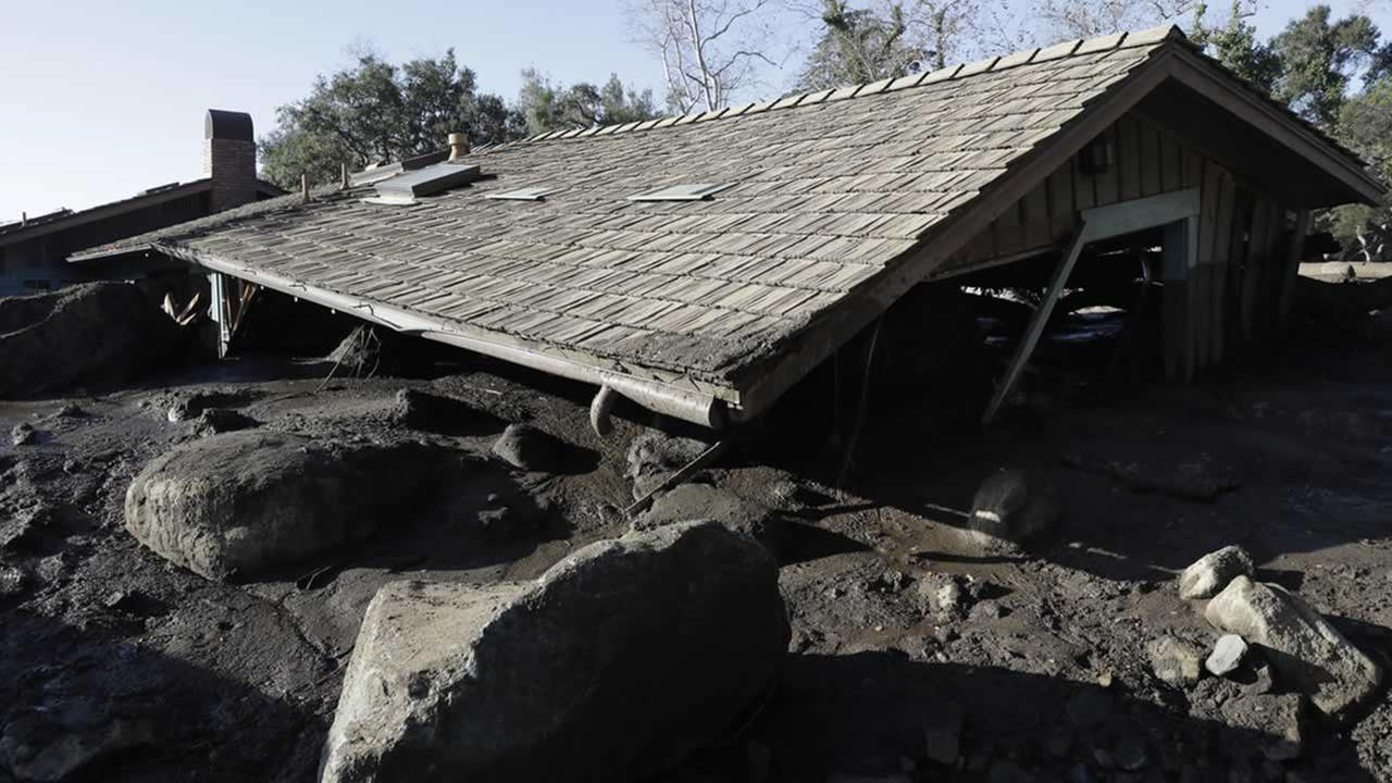 The roof of a structure damaged from storms sits over mud and rocks in Montecito, Calif., Thursday, Jan. 11, 2018.