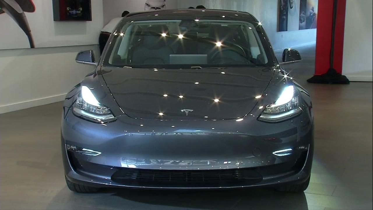 The new Tesla Model 3 appears in the Palo Alto, Calif. showroom on Friday, Jan. 12, 2017.