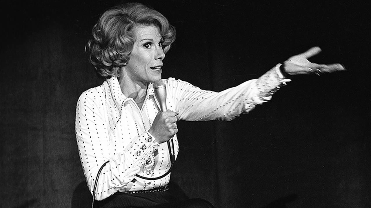 n this Aug. 13, 1975 photo released by the Las Vegas News Bureau, comedian Joan Rivers performs at the MGM in Las Vegas, Nev.nto cardiac arrest at a doctors office. (AP Photo/Las Vegas News Bureau)
