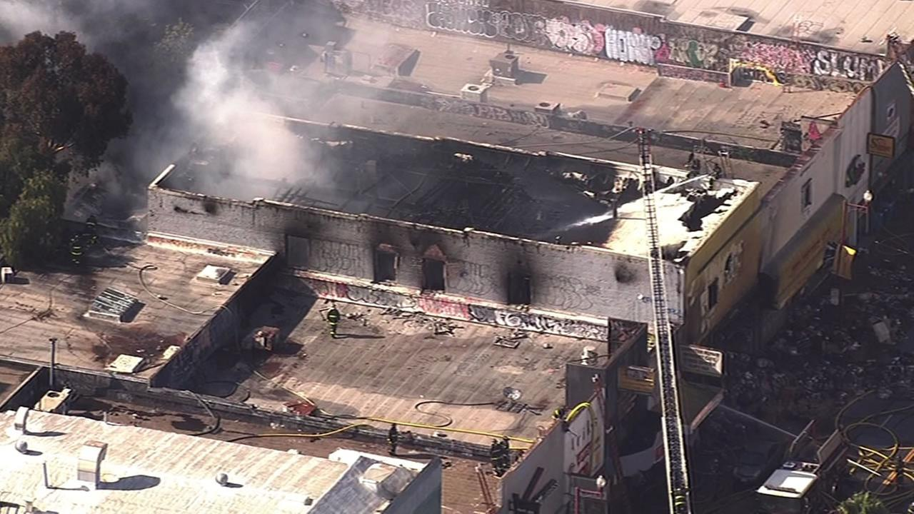 Firefighters battle a five-alarm fire in the Mission District Thursday.